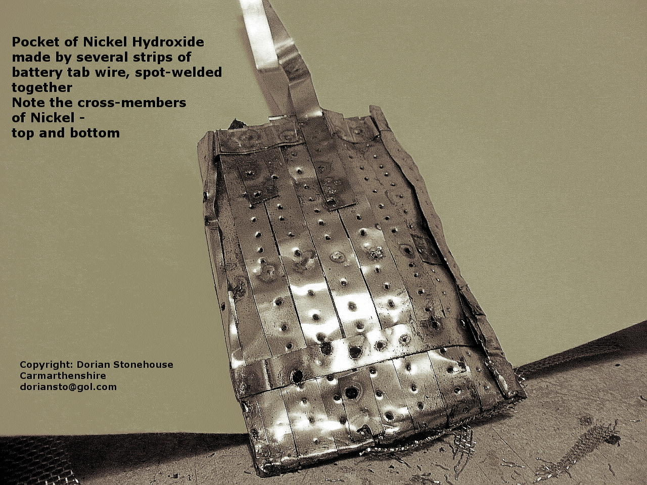Nickel pocket containing nickel hydroxide, and spot welded together using battery tabs