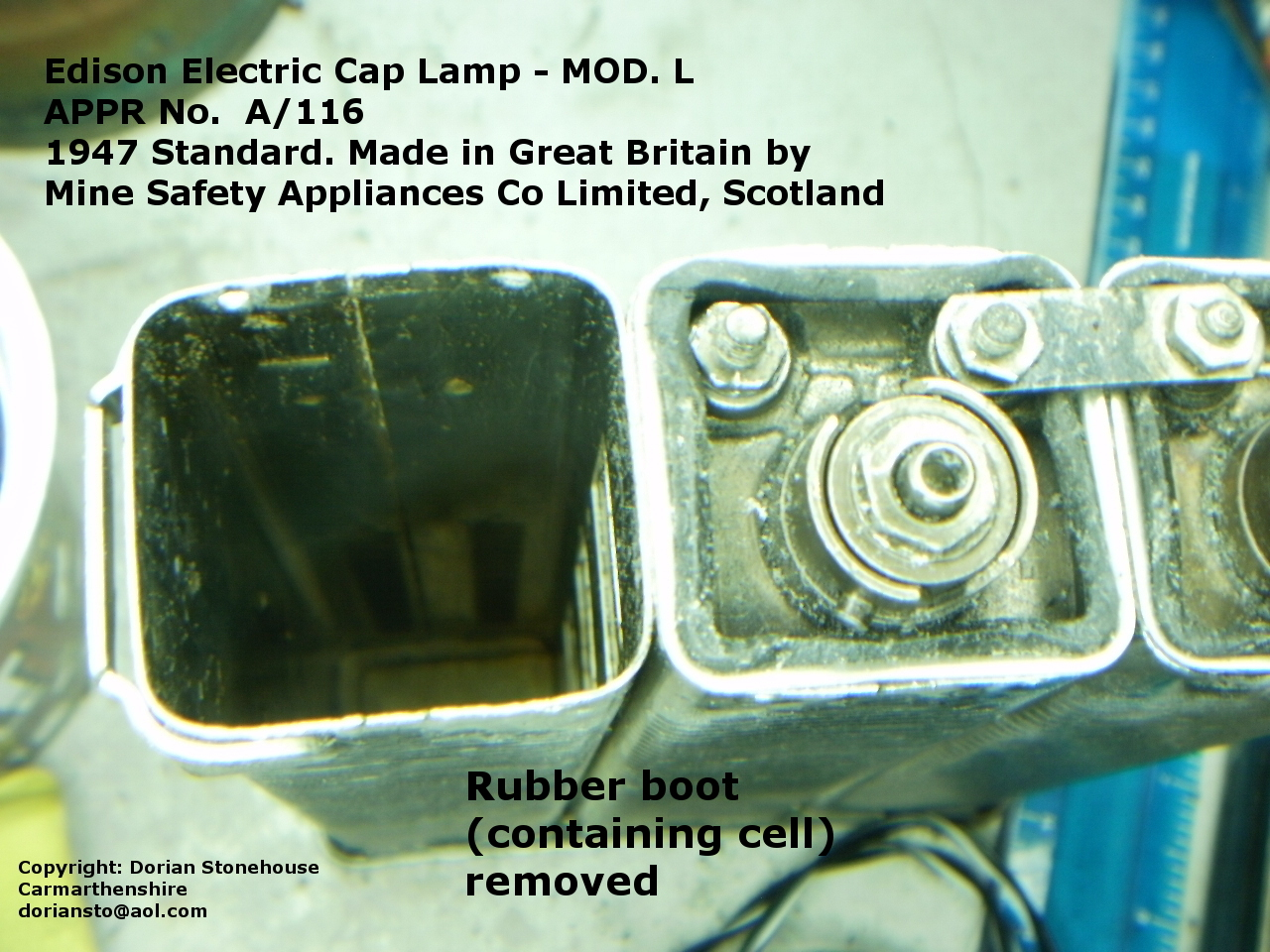 The rubber boot removed from the metal battery body