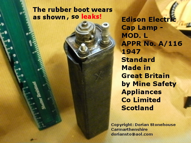 The rubber container boot removed, showing wear and tear of the rubber