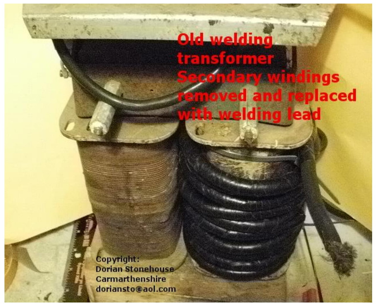 picture of old welding transformer, with two large coils