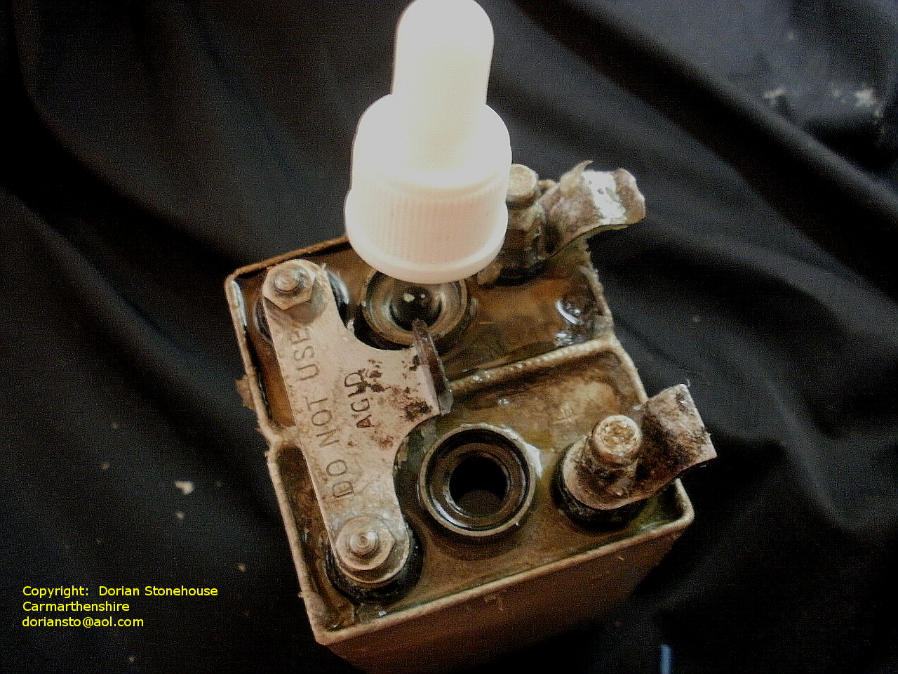 I safely unscrew the cell plugs and wash out and dispose of any old electrolyte and sludge remaining in the cells.