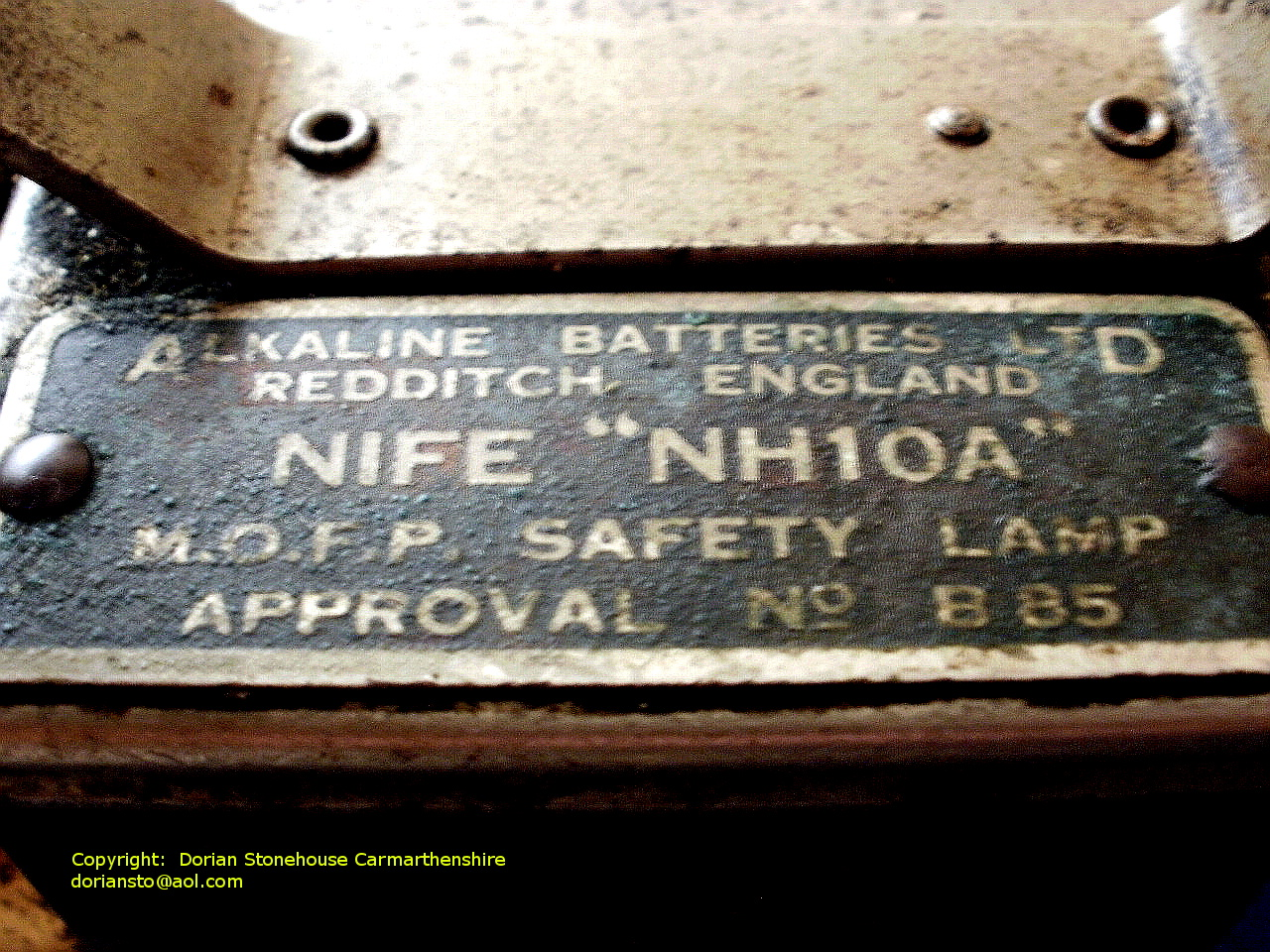"A large plaque with words: NIFE ""NH10A"""