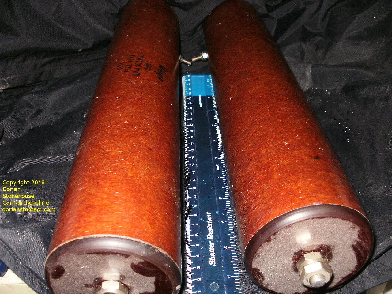 Huge capacitors - over a foot long - end-on view